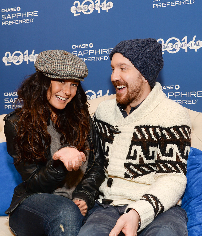 ". Actors Emmanuelle Chriqui, left, and Sam Huntington from the film ""Three Night Stand\"" visit Chase Sapphire on Main Street during the Sundance Film Festival on Monday, Jan. 20, 2014 in Park City, Utah. (Photo by Evan Agostini/Invision for Chase Sapphire Preferred/AP Images)"