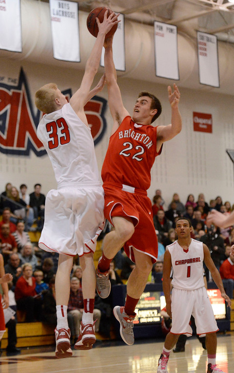 . Brighton\'s Jedidiah Grein (22) gets his shot blocked by Chaparral\'s Hayden Dalton (33) during the fourth quarter February 27, 2013. Chaparral defeated Brighton 59-47. (Photo By John Leyba/The Denver Post)