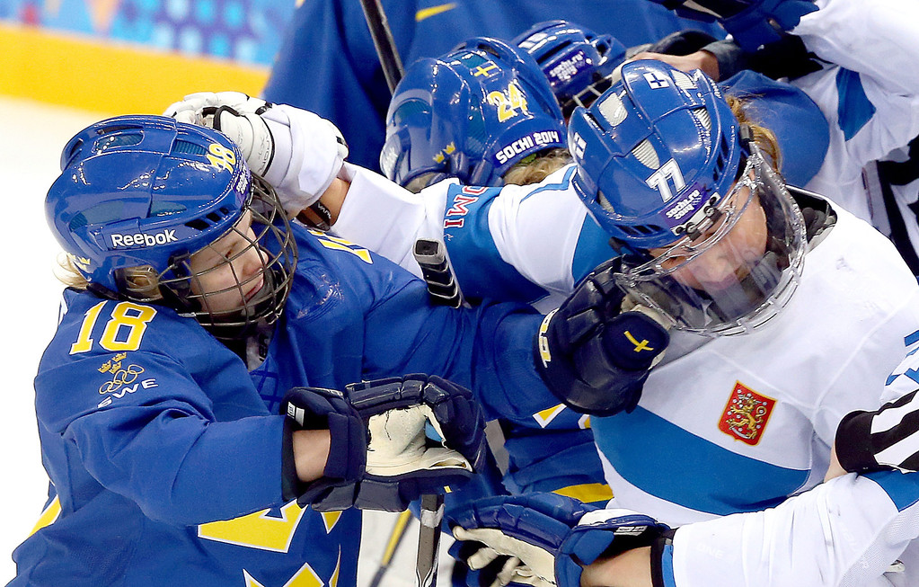 . Anna Borgqvist (L) of Sweden and Susanna Tapani (R) of Finland fight during their quarter final match between Norway and Finland at the Shayba Arena in the women\'s Ice Hockey tournament at the Sochi 2014 Olympic Games, Sochi, Russia, 15 February 2014. Sweden won the game 4-2.  EPA/SRDJAN SUKI