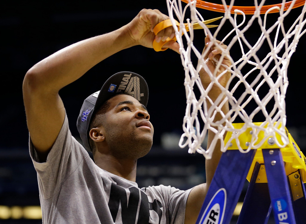. Kentucky Aaron Harrison cuts a piece of the net after an NCAA Midwest Regional final college basketball tournament game Sunday, March 30, 2014, in Indianapolis. Kentucky won 75-72 to advance to the Final Four.  (AP Photo/Michael Conroy)