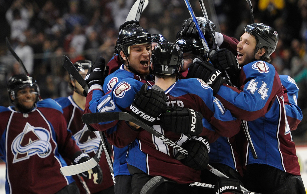 . Colorado Avalanche Kevin Porter (12) gets mobbed by Chris Stewart (25) Ryan Wilson (44) after his game winning goal in overtime to defeat the San Jose Sharks 4-3 November 17, 2010 at Pepsi Center.  John Leyba, The Denver Post