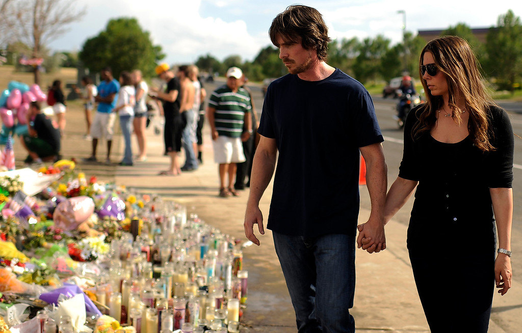 . Christian Bale, star of The Dark Knight Rises, visits the memorial for victims of the movie theater shooting in Aurora, Colo. Sunday, July 24, 2012. Hyoung Chang, The Denver Post
