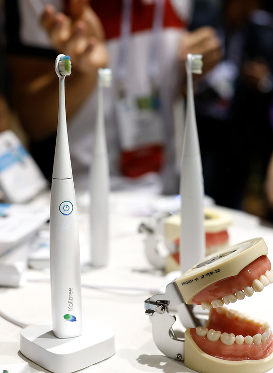 . The Kolibree toothbrush sits on display at the International Consumer Electronics Show, Sunday, Jan. 5, 2014, in Las Vegas. Using Bluetooth wireless, the toothbrush senses how itís moved and can send the information to an Android phone or iPhone and will be able to teach you to brush right and long enough. (AP Photo/Julie Jacobson)
