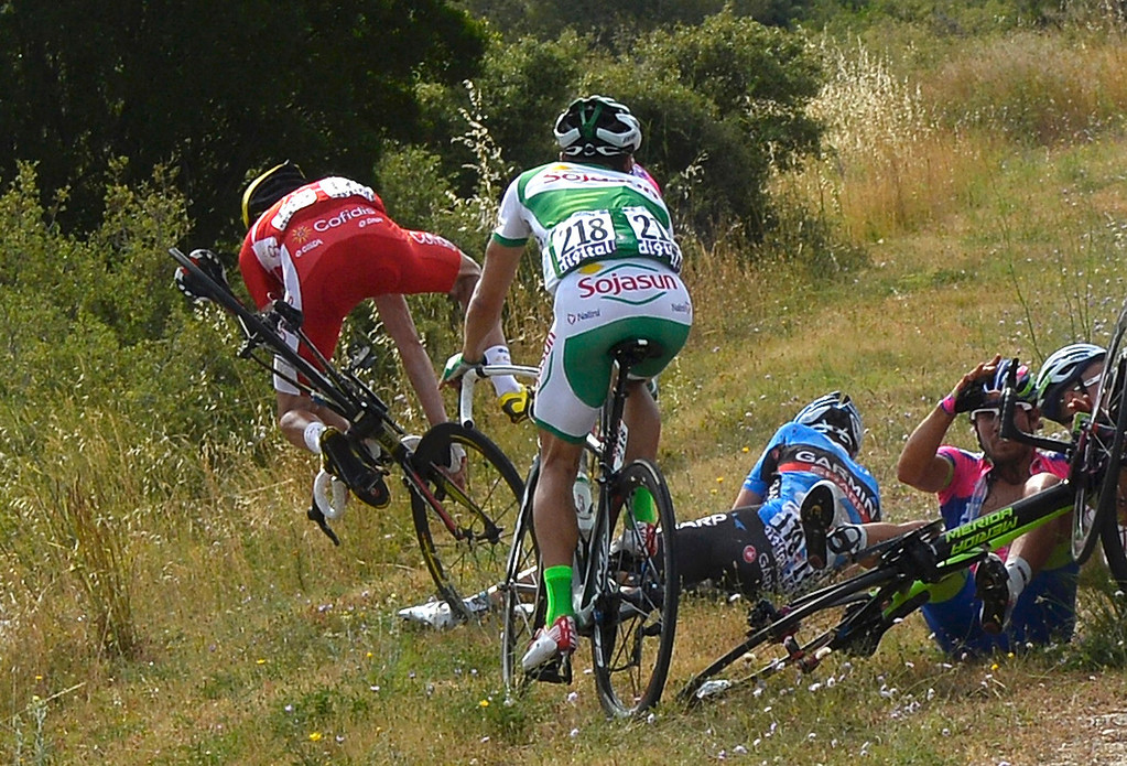 . Riders fall during the 228.5 km fifth stage of the centenary Tour de France cycling race from Cagnes-Sur-Mer to Marseille July 3, 2013.    REUTERS/Jerome Prevost/Pool
