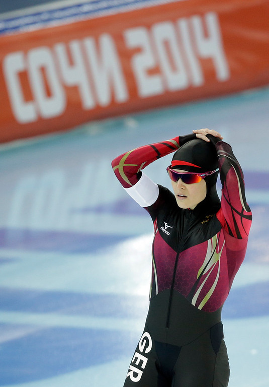 . Germany\'s Judith Hesse shows her disappointment after her disqualification for taking two false starts in the first heat of the women\'s 500-meter speed skating race at the Adler Arena Skating Center during the 2014 Winter Olympics, Tuesday, Feb. 11, 2014, in Sochi, Russia. (AP Photo/Patrick Semansky)