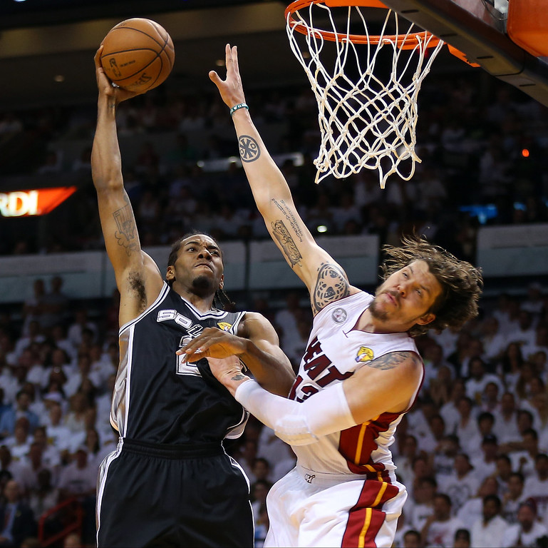 . Kawhi Leonard #2 of the San Antonio Spurs goes up for a dunk over Mike Miller #13 of the Miami Heat in the first quarter of Game Six of the 2013 NBA Finals at AmericanAirlines Arena on June 18, 2013 in Miami, Florida. (Photo by Mike Ehrmann/Getty Images)