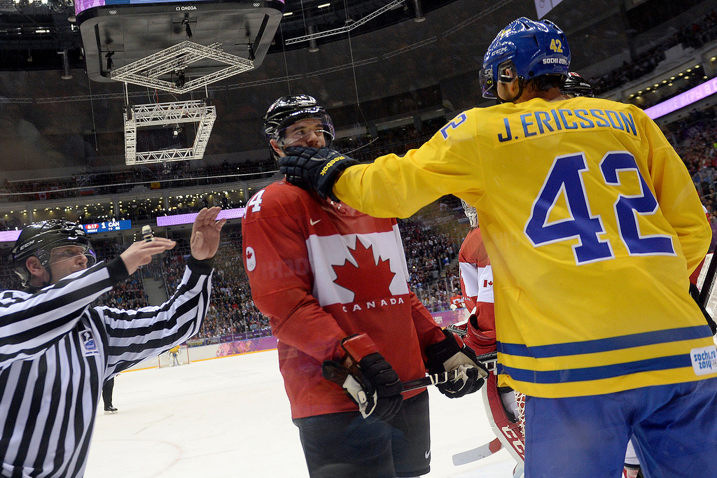 . Jimmie Ericsson (42) of Sweden shoves the face of Marc-Edourd Vlasic (44) of Canada during the second period of the men\'s ice hockey gold medal game. Sochi 2014 Winter Olympics on Sunday, February 23, 2014 at Bolshoy Ice Arena. (Photo by AAron Ontiveroz/ The Denver Post)