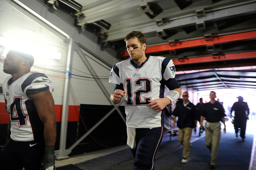 . New England Patriots quarterback Tom Brady (12) leaves the field after the Patriots loss to the Broncos. The Denver Broncos take on the New England Patriots in the AFC Championship game at Sports Authority Field at Mile High in Denver on January 19, 2014. (Photo by AAron Ontiveroz/The Denver Post)
