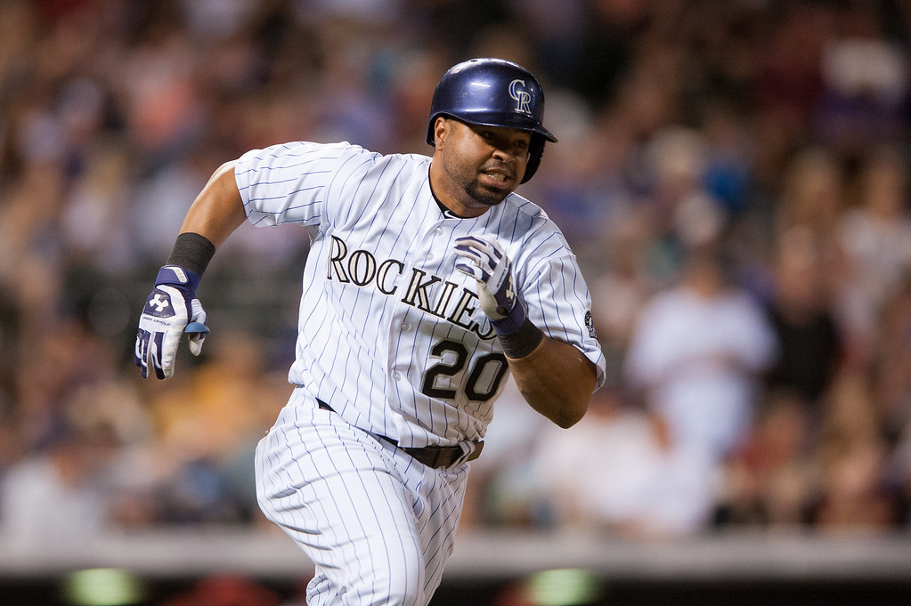 . Wilin Rosario #20 of the Colorado Rockies hustles on a double in the seventh inning of a game against the Arizona Diamondbacks at Coors Field on June 3, 2014 in Denver, Colorado.  The Diamondbacks beat the Rockies 4-2. (Photo by Dustin Bradford/Getty Images)