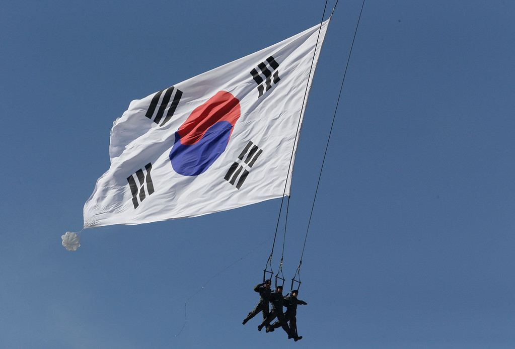 . South Korean Special Army soldiers parachute with their national flag during the media day for the 65th anniversary of Armed Forces Day at Seoul military airport in Seongnam, South Korea, Friday, Sept. 27, 2013.   (AP Photo/Lee Jin-man)
