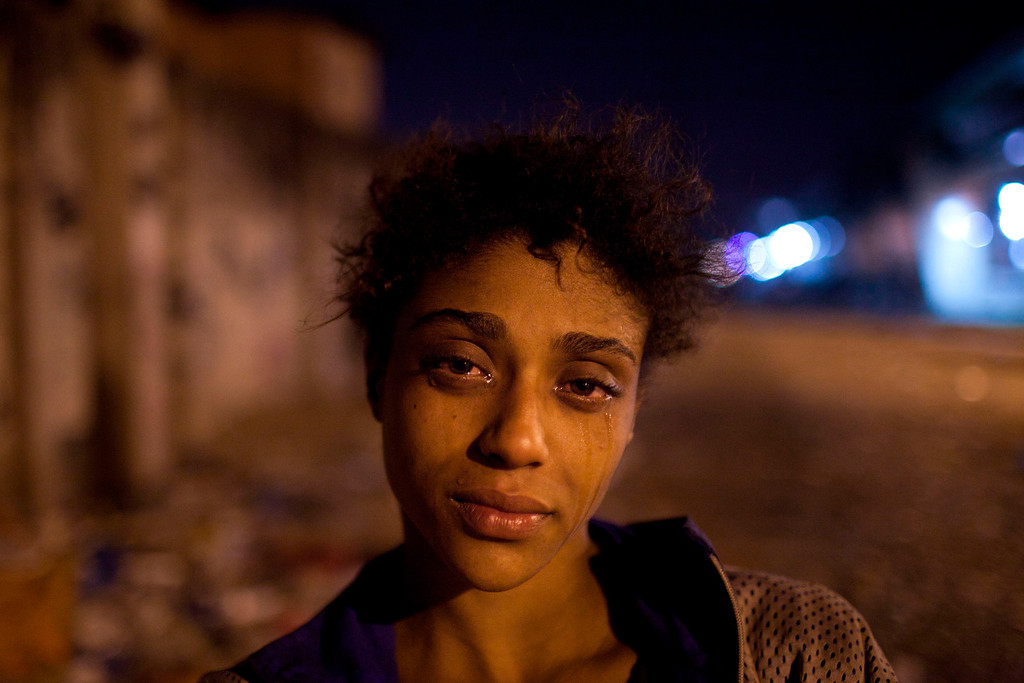 ". In this Aug. 7, 2012 file photo, Natalia Gonzales, a 15-year-old crack user, poses for a portrait in an area known as ""Crackland\"" in the Manguinhos slum in Rio de Janeiro, Brazil. This photo by Associated Press photographer Felipe Dana received an honorable mention for the Contemporary Issues singles category in the World Press Photo 2013 photo contest. (AP Photo/Felipe Dana, File)"