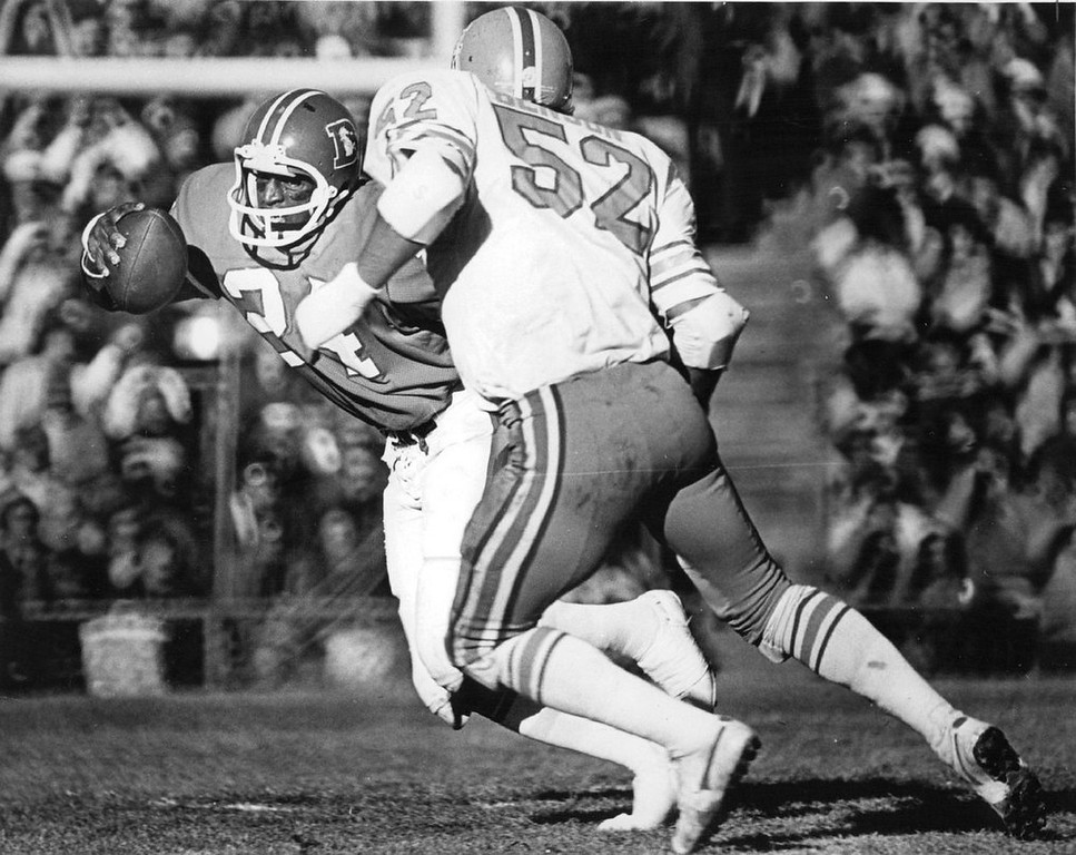 . Sunday\'s hero moves into Denver record book.  Otis Armstrong puts a move on Houston Oiler linebacker Duane Benson, above, during Sunday\'s National Football League game won 37-14 by the Denver Broncos at Mile High Stadium. Armstrong broke two Denver rushing records in the game. (Photo by John J. Sunderland, The Denver Post)