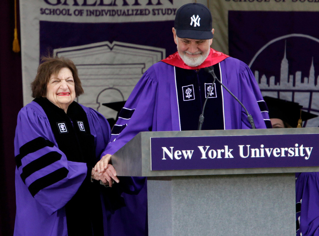 . Veteran White House reporter Helen Thomas, left, smiles while New York university President John Sexton bestows an honorary degree on her at the NYU commencement ceremony at Yankee Stadium in New York, Wednesday, May 13, 2009.  (AP Photo/Seth Wenig)