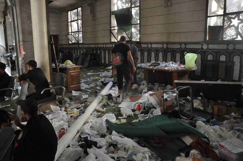 . Debris is scattered inside the al-Fatah mosque, after Islamist protesters barricaded themselves inside the mosque overnight, following a day of fierce street battles that left scores of people dead, near Ramses Square in downtown Cairo, Egypt, Saturday, Aug. 17, 2013. Authorities say police in Cairo are negotiating with people barricaded in a mosque and promising them safe passage if they leave. Muslim Brotherhood supporters of Egypt\'s ousted Islamist president are vowing to defy a state of emergency with new protests today, adding to the tension. (AP Photo/Hussein Tallal)