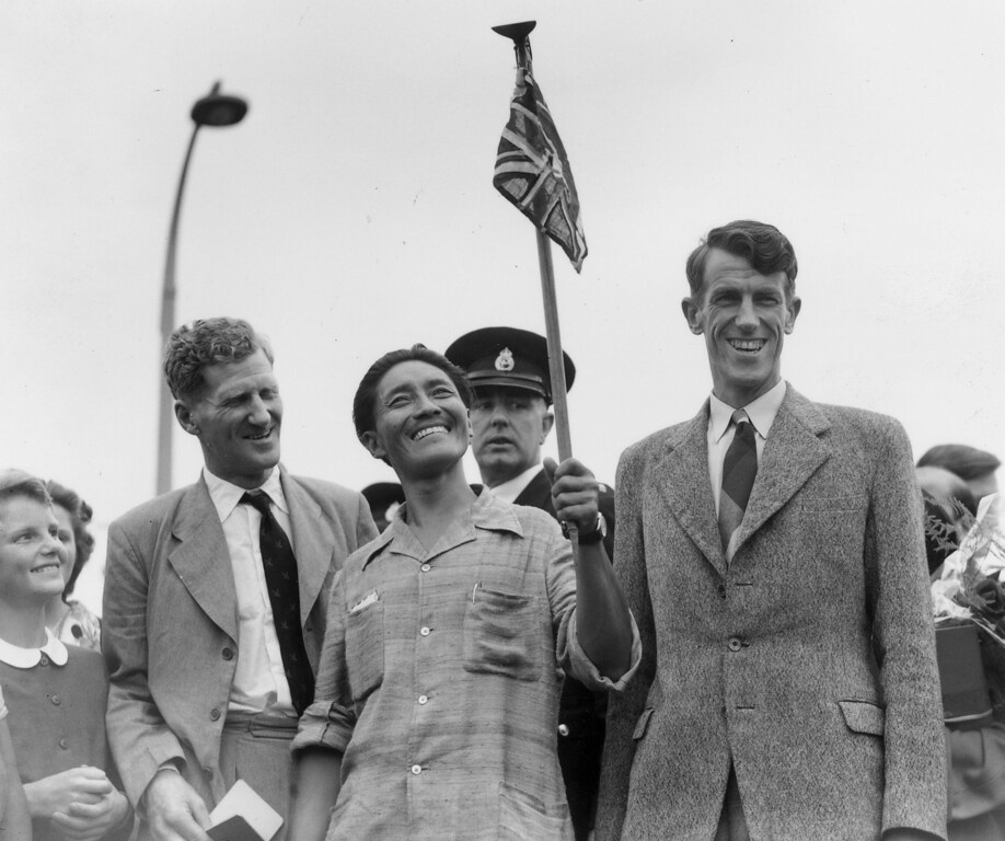 . From left, Colonel John Hunt, Tenzing  Norgay and Edmund Hillary make a jubilant return to Britain after becoming the first men to scale Mount Everest.  May 29, 2013, marked the 60th anniversary since Sir Edmund Hillary and Nepalese Sherpa Tenzing Norgay became the first to reach the summit of Mount Everest on the Nepal-Tibet border.   (Photo by George W. Hales/Fox Photos/Getty Images)