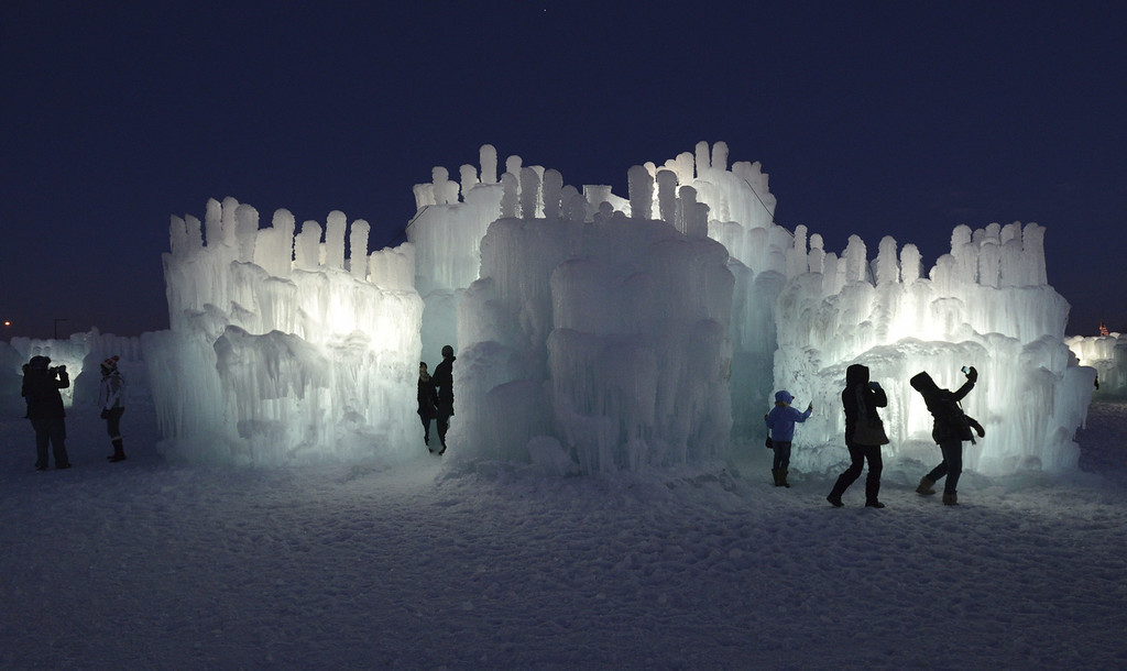 . Visitors explore the 20-foot high Ice Castle at the Mall of America in Bloomington, Minn. on Monday Dec. 31, 2012. The Ice Castle is made of icicles organically grown from four million gallons of water and then fused together.  (AP Photo/Pioneer Press, Chris Polydoroff)