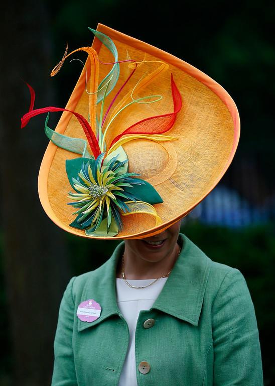 . Racegoer Susan Leuchars arrives for Ladies\' Day at the Royal Ascot horse racing festival at Ascot, southern England June 20, 2013.  REUTERS/Darren Staples
