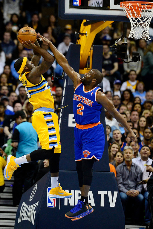 . DENVER, CO - MARCH 13: Raymond Felton (2) of the New York Knicks defends Ty Lawson (3) of the Denver Nuggets during the first half of action. The Denver Nuggets play the New York Knicks at the Pepsi Center. (Photo by AAron Ontiveroz/The Denver Post)