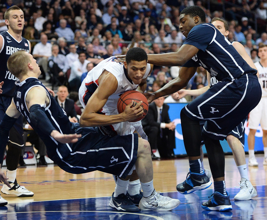 . Angel Nunez #2 of the Gonzaga Bulldogs drives between Nate Austin #33 and Frank Bartley IV #24 of the Brigham Young Cougars during the championship game of the West Coast Conference Basketball tournament at the Orleans Arena on March 11, 2014 in Las Vegas, Nevada.  (Photo by Ethan Miller/Getty Images)