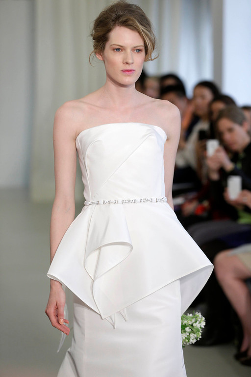 . A bridal collection by Angel Sanchez is modeled in New York, Monday, April 22, 2013.  (AP Photo/Seth Wenig)