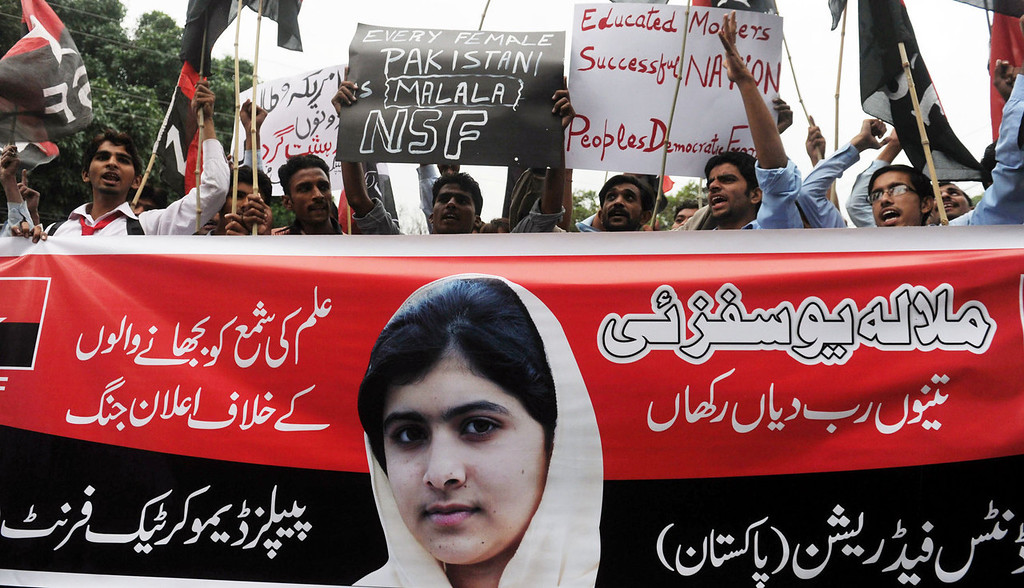 ". Pakistani youths shout slogans during a protest against the assassination attempt by Taliban on child activist Malala Yousafzai in Lahore on October 15, 2012. A teenage Pakistani rights activist was flown to Britain for specialist long-term care on October 15 after being shot in the head by the Taliban for campaigning for the right to education. Malala Yousafzai, 14, who was attacked on her school bus in the former Taliban stronghold of the Swat valley last Tuesday, was sent abroad at a time when her condition is ""optimal and before any unforeseen complications set in\"", the military said.  Arif Ali/AFP/GettyImages"
