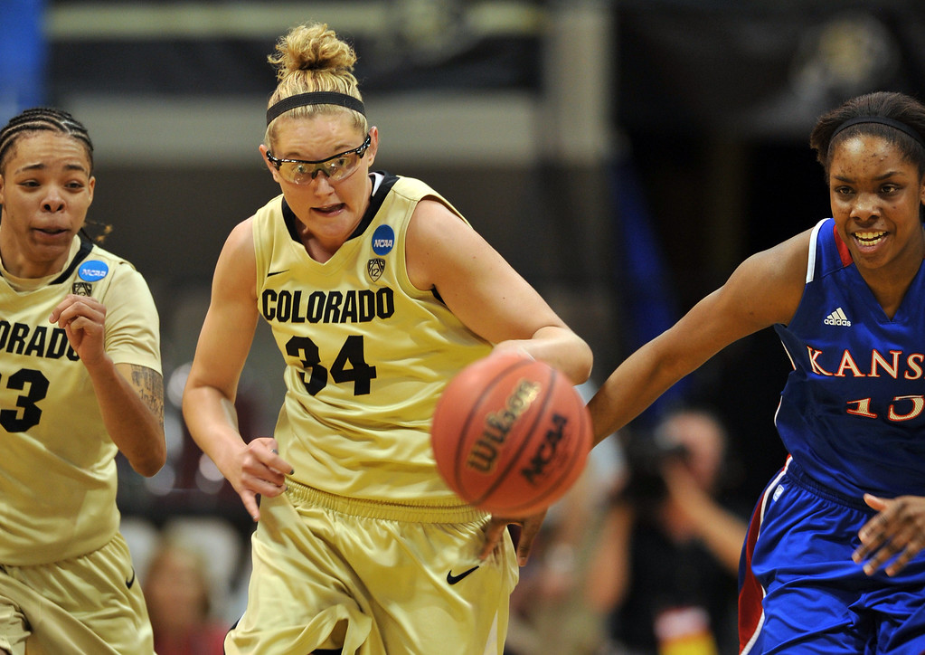 . BOULDER, CO. - MARCH 23: Jen Reese of Colorado Buffaloes (34), center, steals the ball from Chelsea Gardner of Kansas Jayhawks (15), right, during the first round of the 2013 NCAA women\'s Basketball Tournament at Coors Events Center. Boulder, Colorado. March 23, 2013. (Photo By Hyoung Chang/The Denver Post)