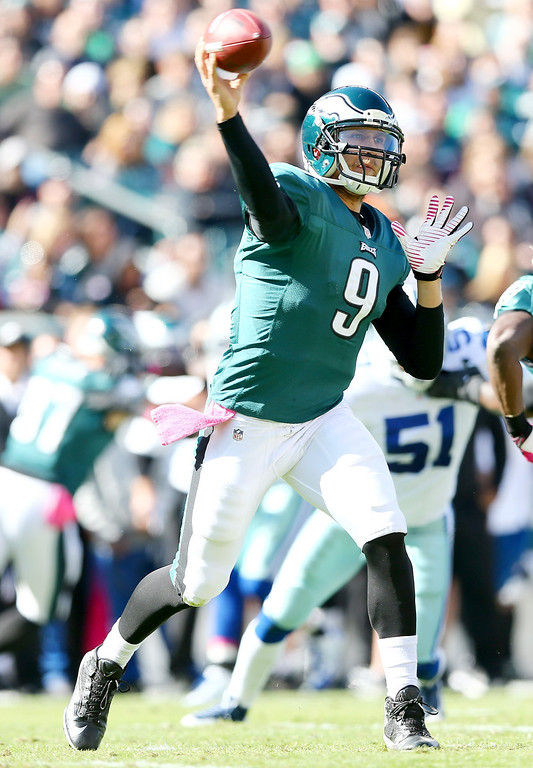 . Nick Foles #9 of the Philadelphia Eagles passes the ball in the first quarter against the Dallas Cowboys on October 20, 2013 at Lincoln Financial Field in Philadelphia, Pennslyvania.  (Photo by Elsa/Getty Images)