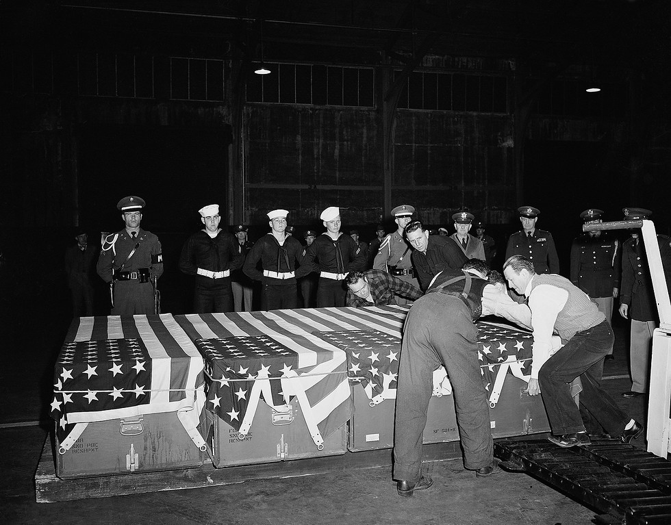 . Armed forces personnel stand at rest behind the flag draped caskets of the first four of 57 Korean War casualties which arrived here aboard the USS General Randall on March 21, 1951. The dead included Maj. General Bryant E. Moore, former commander of U.S. Ninth Corps. (AP Photo/RHH)