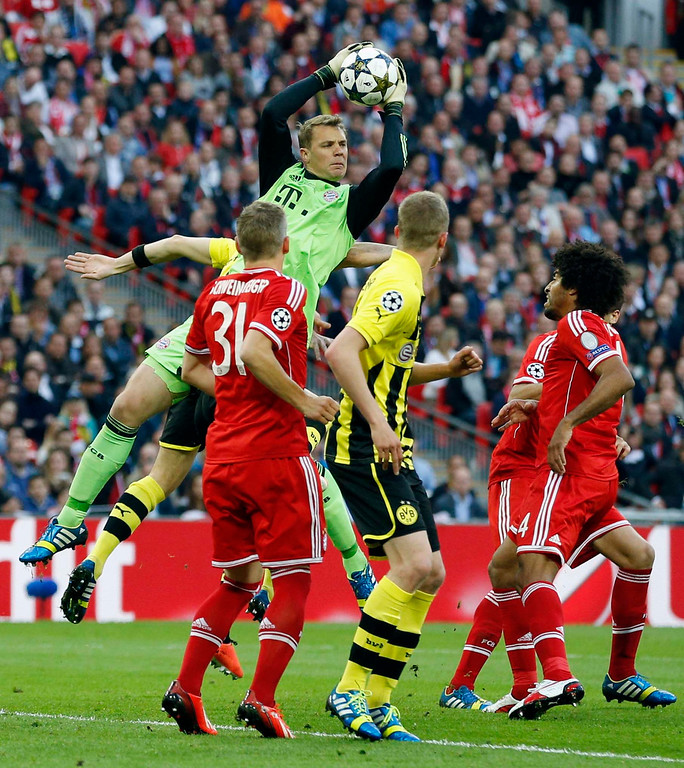 . Bayern goalkeeper Manuel Neuer, centre, in action, during the Champions League Final soccer match between Borussia Dortmund and Bayern Munich at Wembley Stadium in London, Saturday May 25, 2013.  (AP Photo/Matt Dunham)