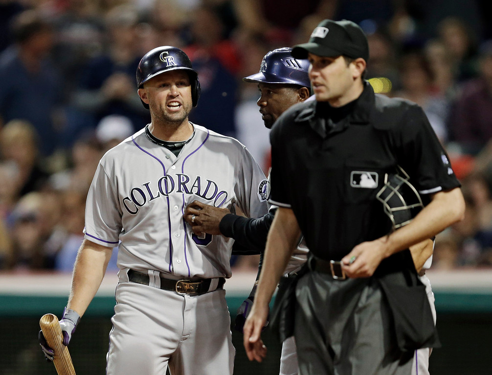 . Colorado Rockies\' Michael Cuddyer, left, barks at home plate umpire John Tumpane after being called out on strikes in the sixth inning of a baseball game against the Cleveland Indians on Friday, May 30, 2014, in Cleveland. (AP Photo/Mark Duncan)