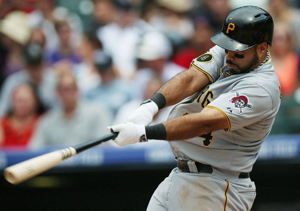 . Pittsburgh Pirates\' Pedro Alvarez grounds into a double play against the Colorado Rockies in the third inning of a baseball game in Denver, Sunday, July 27, 2014. (AP Photo/David Zalubowski)