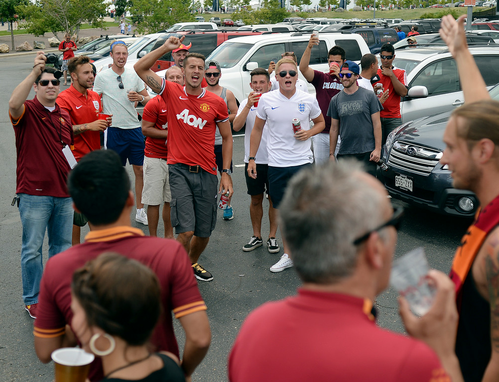 . Manchester United supporters confronted fans of AS Roma in the parking lot before the game. Manchester United took on AS Roma in an exhibition soccer game at Sports Authority Field in Denver Saturday afternoon, July 27, 2014. Photo by Karl Gehring/The Denver Post