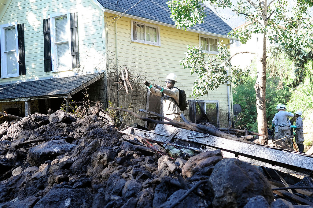 . Flooding that severely damaged numerous homes and businesses along Canon Ave. was in the cleanup stage Tuesday morning.  (Photo By Steve Nehf / The Denver Post)