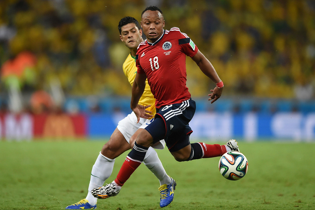 . Colombia\'s defender Juan Camilo Zuniga (R) vies with Brazil\'s forward Hulk during the quarter-final football match between Brazil and Colombia at the Castelao Stadium in Fortaleza during the 2014 FIFA World Cup on July 4, 2014.         EITAN ABRAMOVICH/AFP/Getty Images