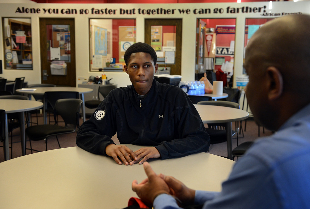 . DENVER, CO. - FEBRUARY 12: Senior Jaycee Floyd talks with Ronald Sally, right, of Project Greer Street following a meeting at East High School in Denver, CO February  07, 2013. The academic program promotes achievement among male African-American high school students. (Photo By Craig F. Walker/The Denver Post)