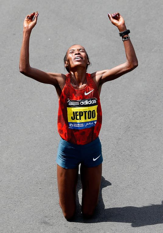 . Rita Jeptoo of Kenya celebrates after winning the 118th Boston Marathon on April 21, 2014 in Boston, Massachusetts.  (Photo by Jim Rogash/Getty Images)