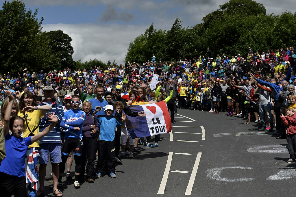 . Supporters are pictured along the road during the 190.5 km first stage of the 101st edition of the Tour de France cycling race on July 5, 2014 between Leeds and Harrogate, northern England. The 2014 Tour de France gets underway on July 5 in the streets of Leeds and ends on July 27 down the Champs-Elysees in Paris. JEFF PACHOUD/AFP/Getty Images
