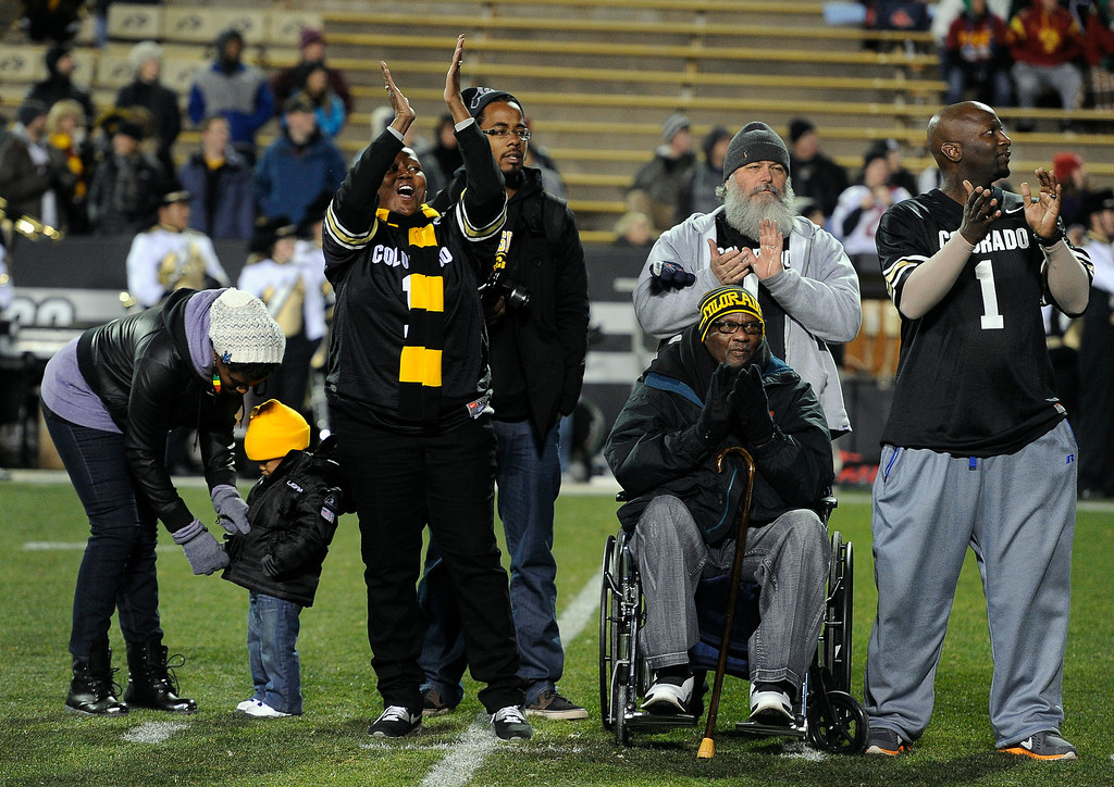 . BOULDER, CO - NOVEMBER 23: The family of senior Derrick Webb, a linebacker for the Colorado Buffaloes football team, cheers as they hear his name called before the start the game against the Southern California Trojans at Folsom Field in mid-November. It is senior day and the last home game of the season, and each senior player is recognized and greeted by family and friends on the field. From left to right are Derrick\'s sister BreAnna Scott and her son Ezekiel Brookins, 2, Derrick\'s mother Felicia Morris, BreAnna\'s fiance Mikel Brookins, Felicia\'s husband Billy Morris, Derrick\'s grandfather Harold Scott (wheelchair) and Derrick\'s uncle, Kevin Scott. (Photo by Kathryn Scott Osler/The Denver Post)