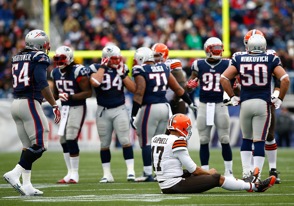 . Jason Campbell #17 of the Cleveland Browns sits on the field following an incomplete pass against the New England Patriots in the second quarter during the game at Gillette Stadium on December 8, 2013 in Foxboro, Massachusetts.  (Photo by Jared Wickerham/Getty Images)