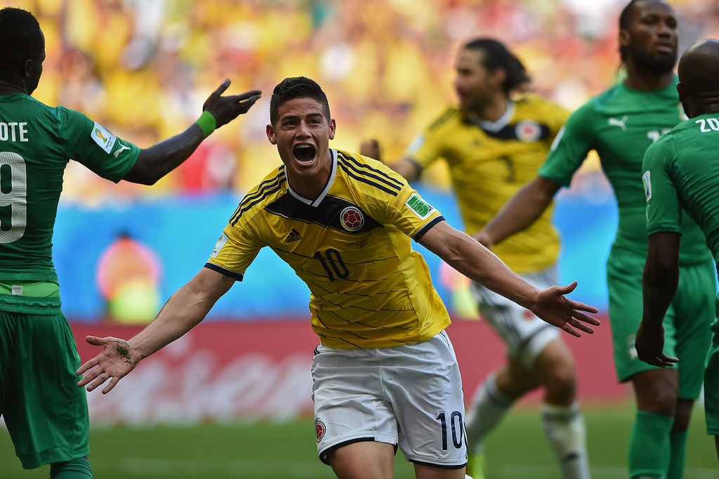 . Colombia\'s midfielder James Rodriguez celebrates scoring during a Group C football match between Colombia and Ivory Coast at the Mane Garrincha National Stadium in Brasilia during the 2014 FIFA World Cup on June 19, 2014. EITAN ABRAMOVICH/AFP/Getty Images