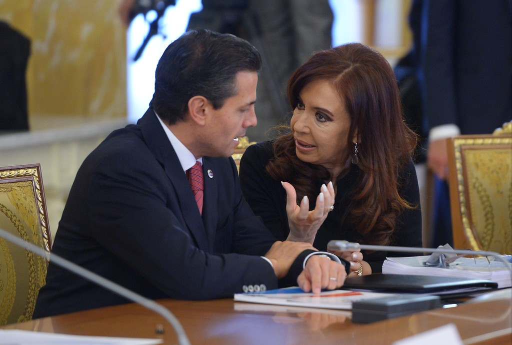 . PETERSBURG, RUSSIA - SEPTEMBER 06:  In this handout image provided by Host Photo Agency, President of Argentina Cristina Fernandez de Kirchner and Mexican President Enrique Pena Nieto attend the second working meeting of the G20 heads of state and government, heads of invited states and international organizations at the G20 Summit on September 6, 2013 in St. Petersburg, Russia. Leaders of the G20 nations made progress on tightening up on multinational company tax avoidance, but remain divided over the Syrian conflict as they enter the final day of the Russian summit. (Photo by Grigoriy Sisoev/Host Photo Agency via Getty Images)