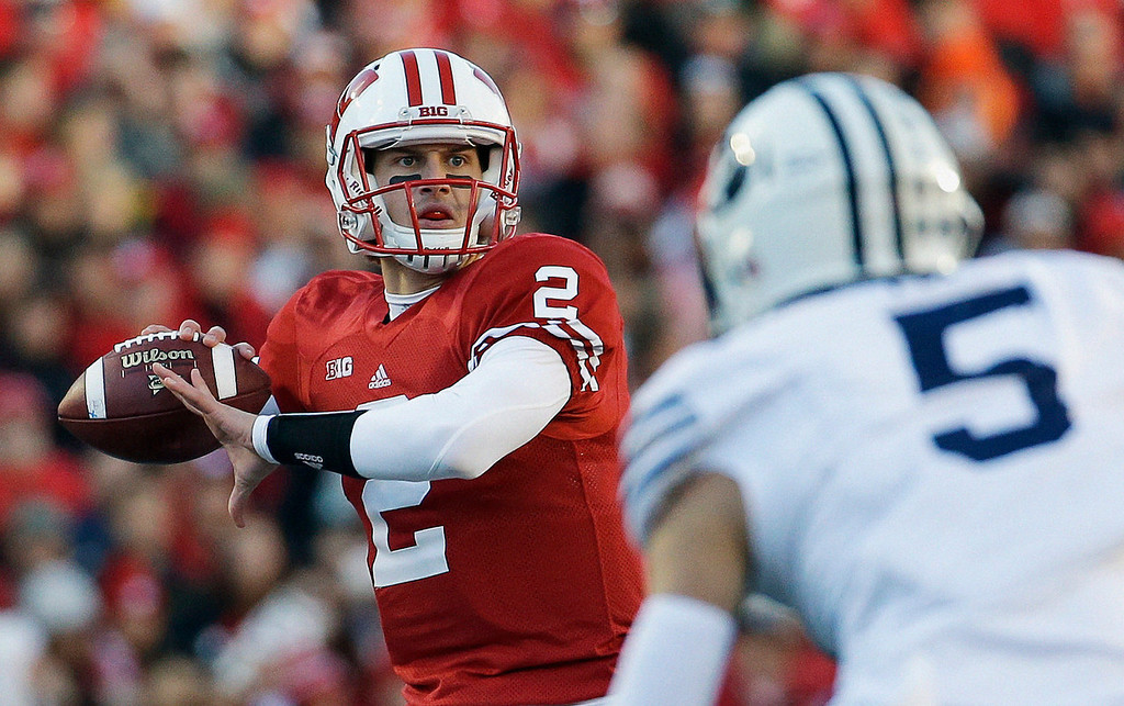 . Wisconsin quarterback Joel Stave drops back to pass during the first half of an NCAA college football game against Brigham Young, Saturday, Nov. 9, 2013, in Madison, Wis. (AP Photo/Morry Gash)