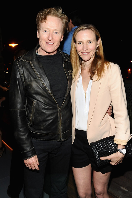 . TV host Conan O\'Brien (L) and  Liza Powel OBrien attend Coach\'s 3rd Annual Evening of Cocktails and Shopping to Benefit the Children\'s Defense Fund hosted by Katie McGrath, J.J. Abrams and Bryan Burk at Bad Robot on April 10, 2013 in Santa Monica, California.  (Photo by Stefanie Keenan/Getty Images for Coach)