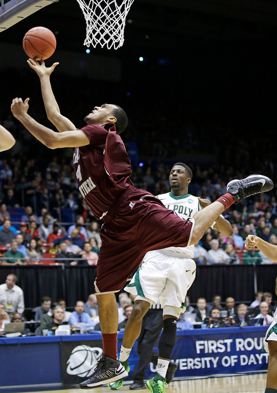 . Texas Southern forward Jose Rodriguez (4) drives against Cal Poly in the second half of a first-round game of the NCAA college basketball tournament on Wednesday, March 19, 2014, in Dayton, Ohio. (AP Photo/Al Behrman)