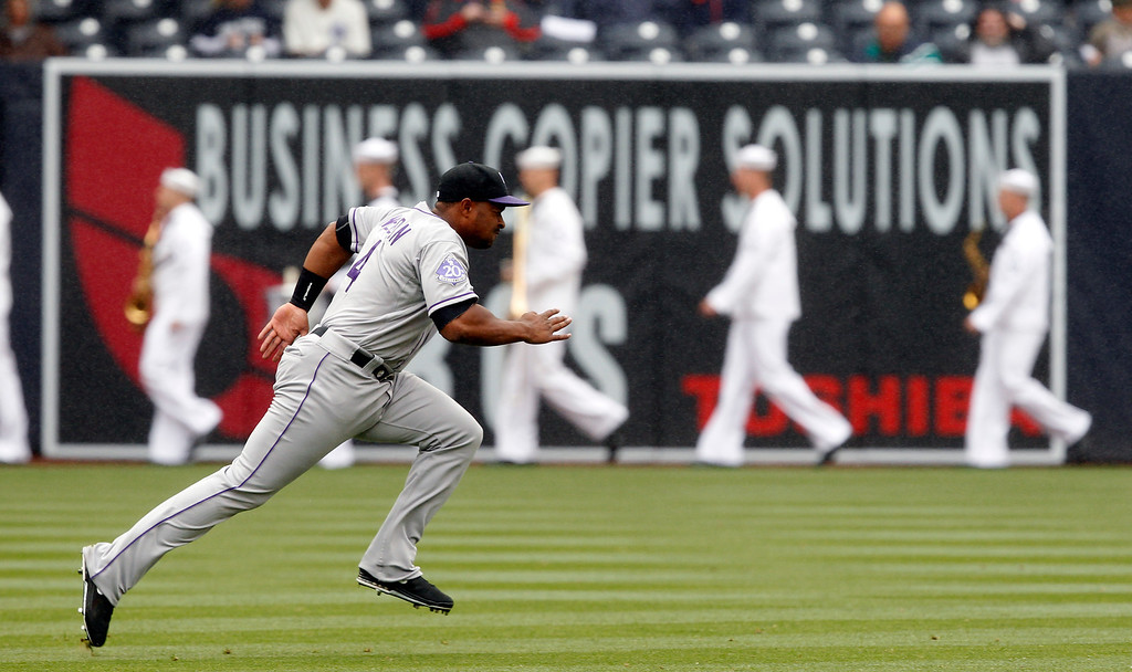 . Colorado Rockies third baseman Chris Nelson (4) runs wind sprints to warm up before playing against the San Diego Padres in a baseball game on Sunday, April 14, 2013, in San Diego. (AP Photo/Alex Gallardo)