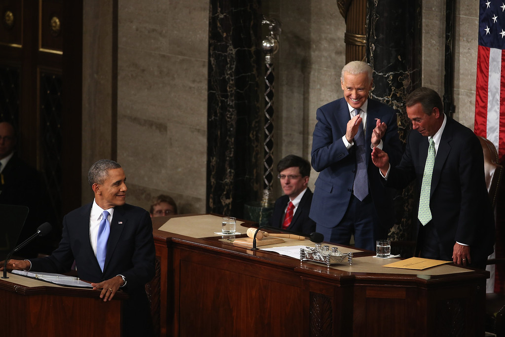 . WASHINGTON, DC - JANUARY 28:  U.S. President Barack Obama looks back at U.S. Vice President Joe Biden and Speaker of the House U.S. Rep. John Boehner (R-OH)  delivers the State of the Union address to a joint session of Congress in the House Chamber at the U.S. Capitol on January 28, 2014 in Washington, DC. In his fifth State of the Union address, Obama is expected to emphasize on healthcare, economic fairness and new initiatives designed to stimulate the U.S. economy with bipartisan cooperation.  (Photo by Mark Wilson/Getty Images)