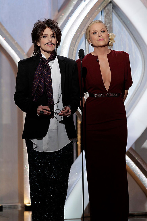 . This image released by NBC shows co-hosts Tina Fey, left, and Amy Poehler on stage during the 70th Annual Golden Globe Awards at the Beverly Hilton Hotel on Jan. 13, 2013, in Beverly Hills, Calif. (AP Photo/NBC, Paul Drinkwater)