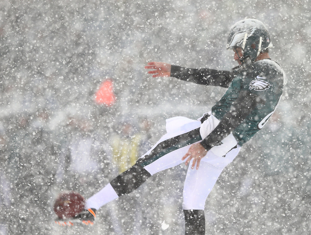 . Donnie Jones #8 of the Philadelphia Eagles punts the ball in the first quarter against the Detroit Lions on December 8, 2013 at Lincoln Financial Field in Philadelphia, Pennslyvania.  (Photo by Elsa/Getty Images)