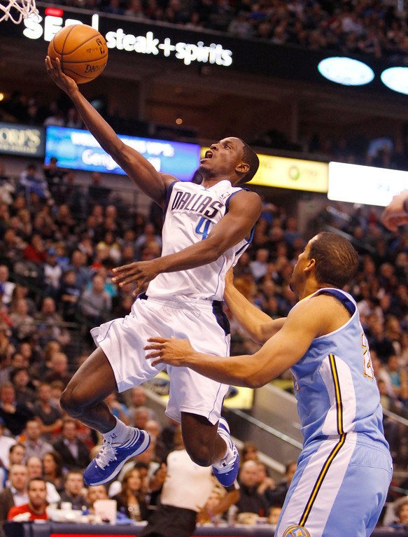 . The Dallas Mavericks\' Darren Collison (4) goes up for a shot past the Denver Nuggets\' Andre Miller at the American Airlines Center in Dallas, Texas, on Friday, December 28, 2012. (Richard W. Rodriguez/Fort Worth Star-Telegram/MCT)