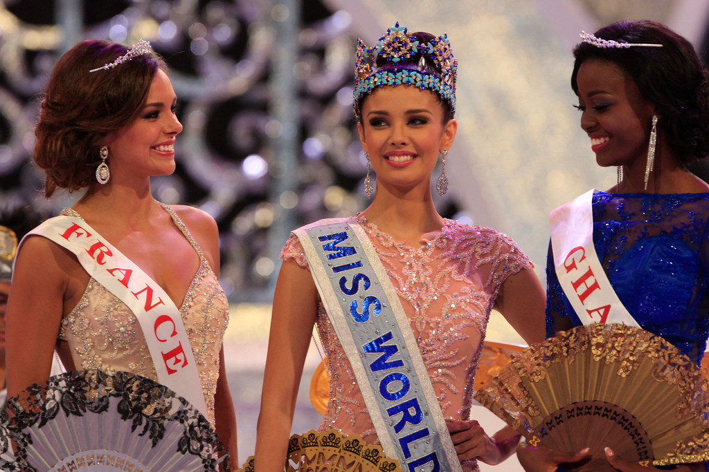 . Newly crowned Miss World, Megan Young of Philippines, center, with second runner-up Miss France Marine Lorpheline, left, and third runner-up Miss Ghana Carranza Naa Okailey Shooter, smile after they winning the Miss World contest in Nusa Dua, Bali, Indonesia, Saturday, Sept. 28, 2013. (AP Photo/Firdia Lisnawati)
